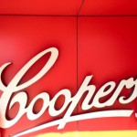 two people standing next to the Coopers logo