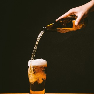 beer is being filled into a glass