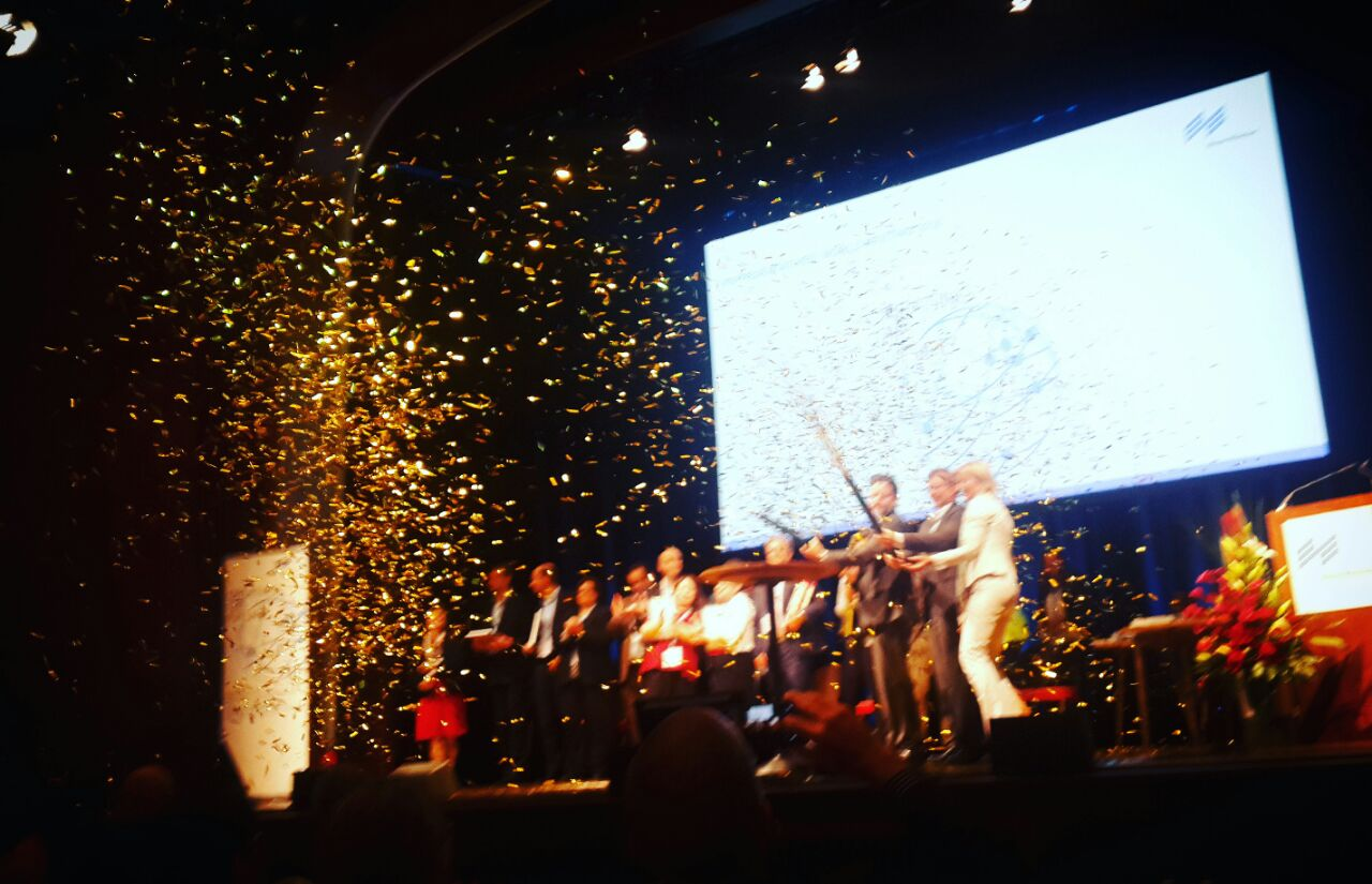 people on a stage celebrating with confetti