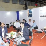 many men sitting at tables and having buyer seller meetings