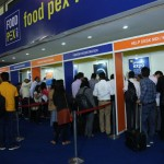 people standing in lines at the entrance at the drinktec India