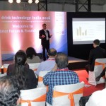 a man speaking on a stage at the exhibition forum at the drinktec India