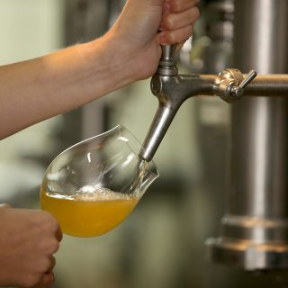 A person tapping beer