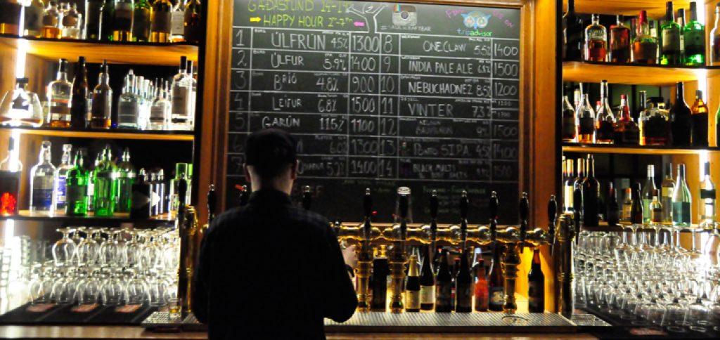 A stylish bar and a bar keeper working