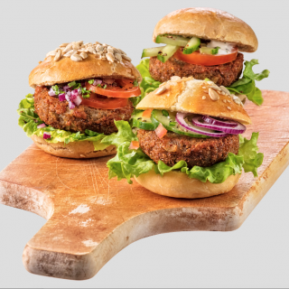 Three delicious looking burgers on a cutting board