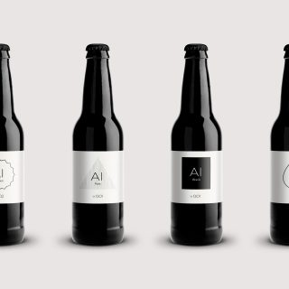 Four black bottles in a row