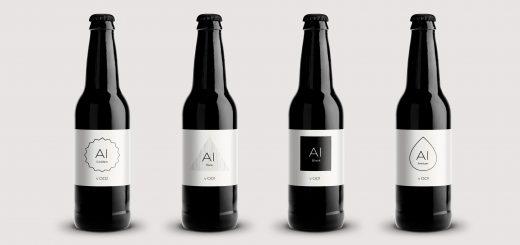 Vier schwarze Flaschen in einer Reihe