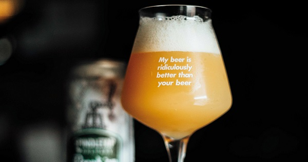 Beer in beer glass with funny saying