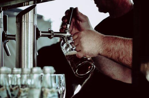 Beer glass filled at bar
